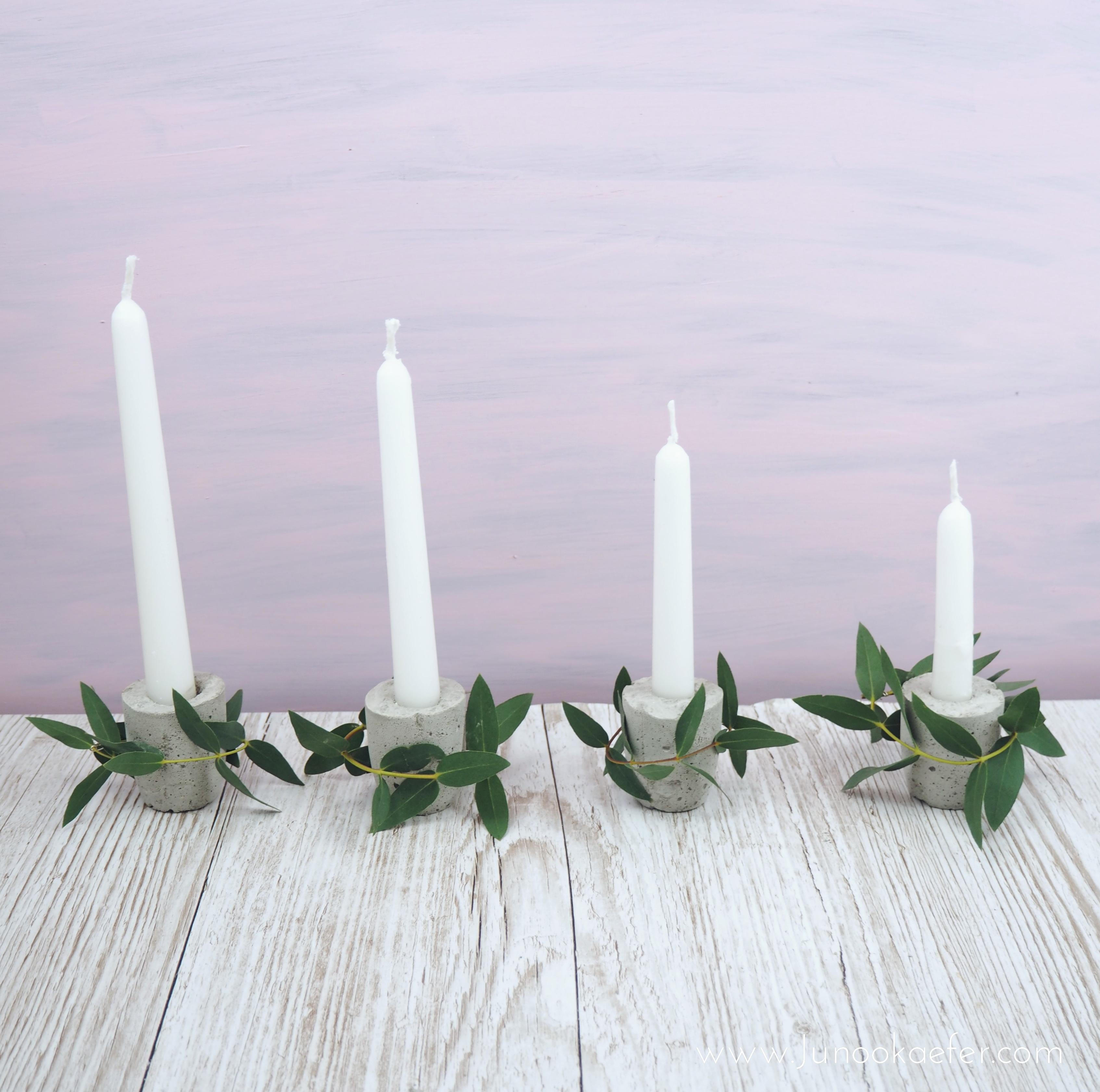 Adventskranz mit rosa Hintergrund